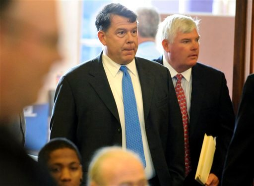 Matthew Amorello, former head of Boston's Big Dig highway project, center, enters the courtroom with his attorney William Hogan III, right, before his arraignment at Haverhill District Court on drunken driving charges, Tuesday, Aug. 24, 2010, in Haverhill, Mass. (AP Photo/Lisa Poole, Pool)
