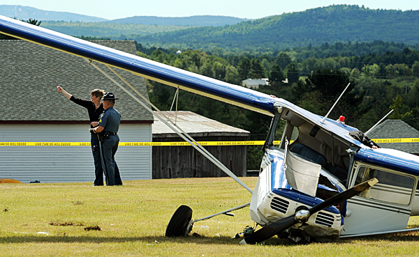 Maine State Police Sgt. Mark Brooks takes a witness statement from Emily Griffin after a Cessna 140 tail dragger crashed on a grass airstip off the Pember Road in Levant on Monday, Septermber 6, 2010.   BANGOR DAILY NEWS PHOTO BY KEVIN BENNETT