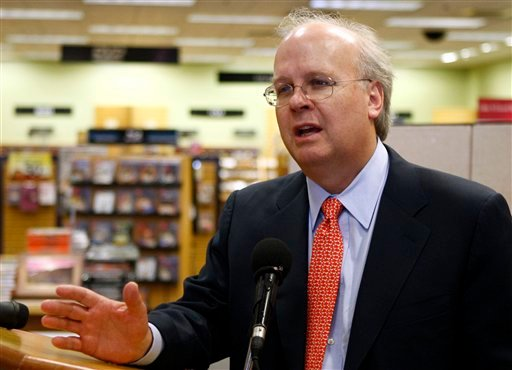 FILE - In this May 17, 2010 file photo, former White House adviser  Karl Rove gestures in Oklahoma City. Turns out politics, for all its focus on the gloomy economy, is a recession-proof industry. This year's volatile election is bursting at the seams with money, setting fundraising and spending records in a high-stakes struggle for control of Congress amid looser but still fuzzy campaign finance rules. (AP Photo/Sue Ogrocki, File)