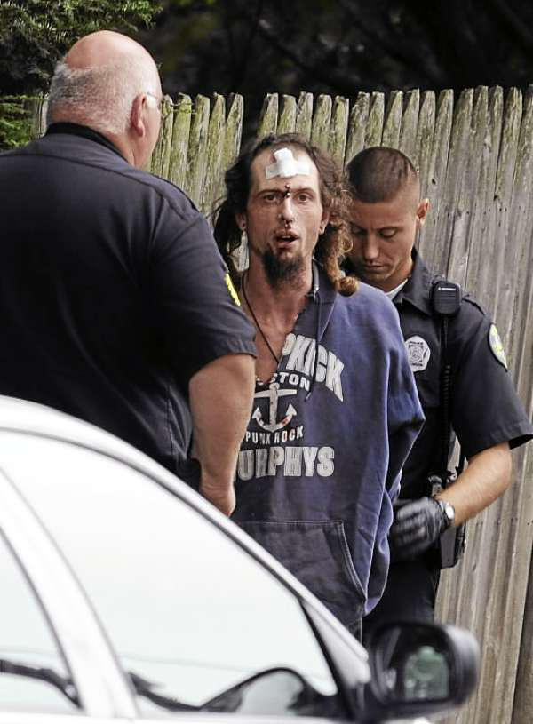 Bangor police arrest a man on Garland Street on Tuesday afternoon, September 7, 2010 after he allegedly pulled a knife on a woman. (Bangor Daily News/Kevin Bennett)