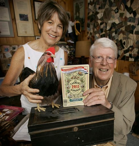 In this Sept. 1, 2010 photo, editor Janice Stillman, left, and editor-in-chief Jud Hale pose in Dublin, N.H., with the 2011 edition of the Old Farmer's Almanac on top of the lock box Hale says has the secret formula to predict weather. The 219-year-old &quotOld Farmer's Almanac&quot and its longtime New England competitor, the Maine-based &quotFarmer's Almanac,&quot still draw droves of fans despite the age of the Internet and mobile phone apps. The books, which use their own &quotsecret formula&quot to predict weather based on sunspots, planetary positions and other information, are popular at farmers markets and bookstores and have maintained a fan base that sometimes goes back generations in families. (AP Photo/Jim Cole)