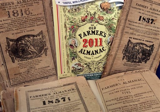 In this Sept. 1, 2010 photo taken in Dublin, N.H., the latest edition of the Old Farmer's Almanac is mixed in with older editions. The 219-year-old &quotOld Farmer's Almanac&quot and its longtime New England competitor, the Maine-based &quotFarmer's Almanac,&quot still draw droves of fans despite the age of the Internet and mobile phone apps. The books, which use their own &quotsecret formula&quot to predict weather based on sunspots, planetary positions and other information, are popular at farmers markets and bookstores and have maintained a fan base that sometimes goes back generations in families. (AP Photo/Jim Cole)