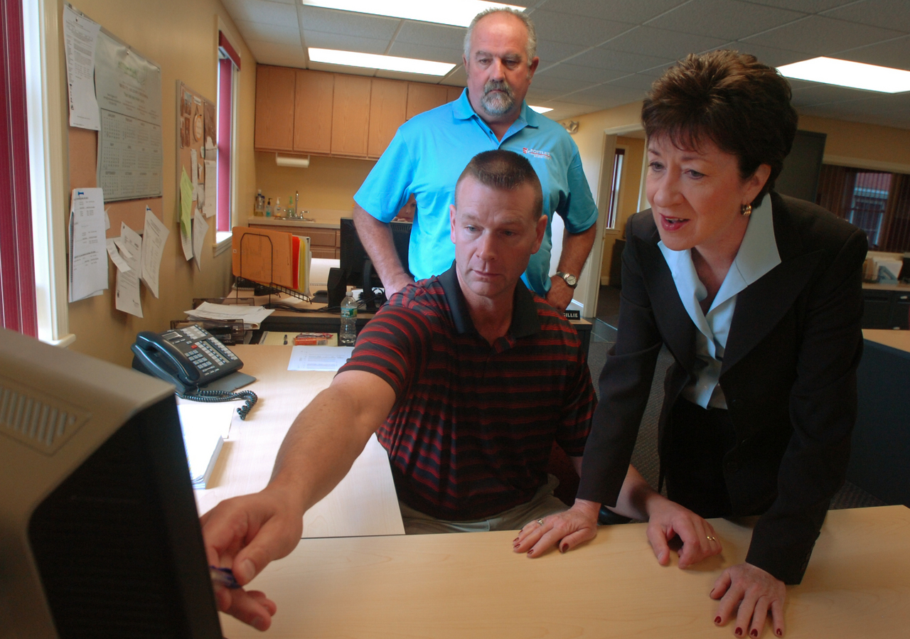 U. S. Senator Susan Collins, right, looks at a computer screen as Pottle's Transportation Operations Manager Rick Randall, center, shows her the company's dispatch system in Hermon on Wednesday, September 8, 2010, as Pottle's CEO Barry Pottle watches. Collins, who is visiting small businesss to hear their concerns during the Congressional recess, toured the trucking facility and answered questions regarding the expiration of weight limits on the interstate.  (Bangor Daily News/Kevin Bennett)