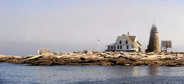 The College of the Atlantic's Mount Desert Rock research station viewed from the north side of the island.  The structures pictured from right are: solar panels that provide power to the lighthouse, granite lighthouse built in 1847, the former lighthouse keeper's house that is home to researchers during the summer whale research seasons.  The structure on the far left is the remaining wall from the boat house that was washed away by Huricane Bill in 2009. (Bangor Daily News/Gabor Degre)
