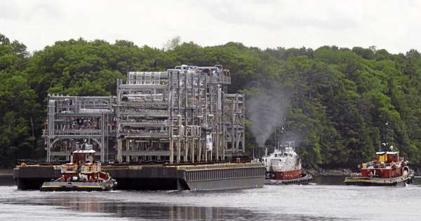 The last shipment of oil refinery modules leaves the Cianbro company's Brewer manufacturing facility Friday afternoon, June 4, 2010.  The barge was loaded with seven modules that completes the total of 51 that were to be manufactured.  Cianbro  vice president and general manager Joe Cote said that facility is not shutting down. They are in negotiations with several major companies and hope to get more work before the end of the Summer.  Most of the over 500 people who worked at the Brewer facility were transfered to other projects. (Bangor Daily News/Gabor Degre)