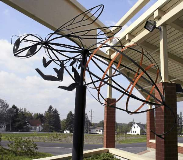 THIS METAL HORNET SCULPTURE, which was created by the metal class in the late 1990s, under the direction of instructor David Morrow, used to sit in front of the Ashland Community High School. The hornet was taken out last fall and refurbished and is now proudly displayed in front of the Ashland District School. Staff photo/Scott Mitchell Johnson