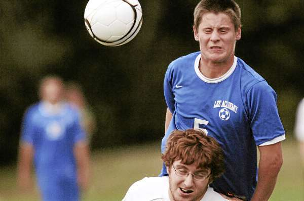 Lee Academy's Tyler White, (5), collides with MA 's Dillon Hesseltine,(35),  for a header in the second half of their game in Lincoln, Thursday, Sept. 9, 2010. Bangor Daily News/Michael C. York