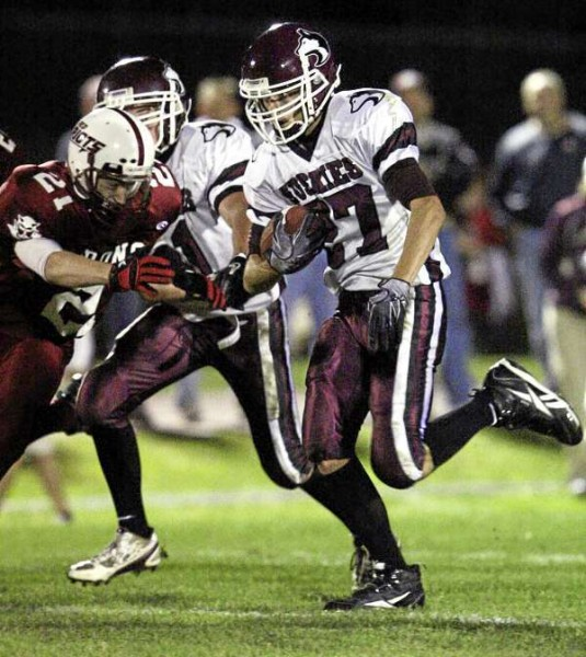 JASON P. SMITH. . . . Maine Central Institute's Trey Vintinner moves the ball down field past Orono High School's Tannar Francis during their game at Orono High School on Friday, September 10, 2010.