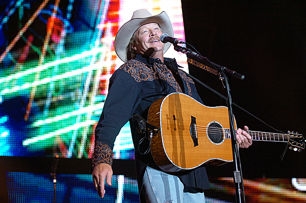 Alan Jackson greets the crowd of more than 8,000 fans at the start of his show Friday, Sept. 10, 2010 which was part of the Bangor Waterfront Concert Series. (Bangor Daily News/Bridget Brown)