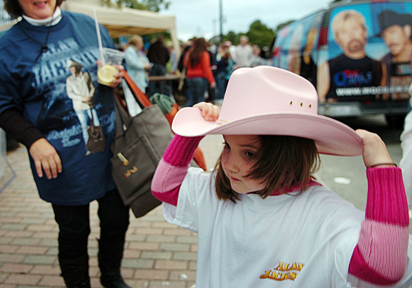 Rachel Murphy, 4, of Hermon adjusts her cowgirl hat prior to attending her first concert Friday, Sept. 10, 2010 on the Bangor Waterfront. (Bangor Daily News/Bridget Brown)