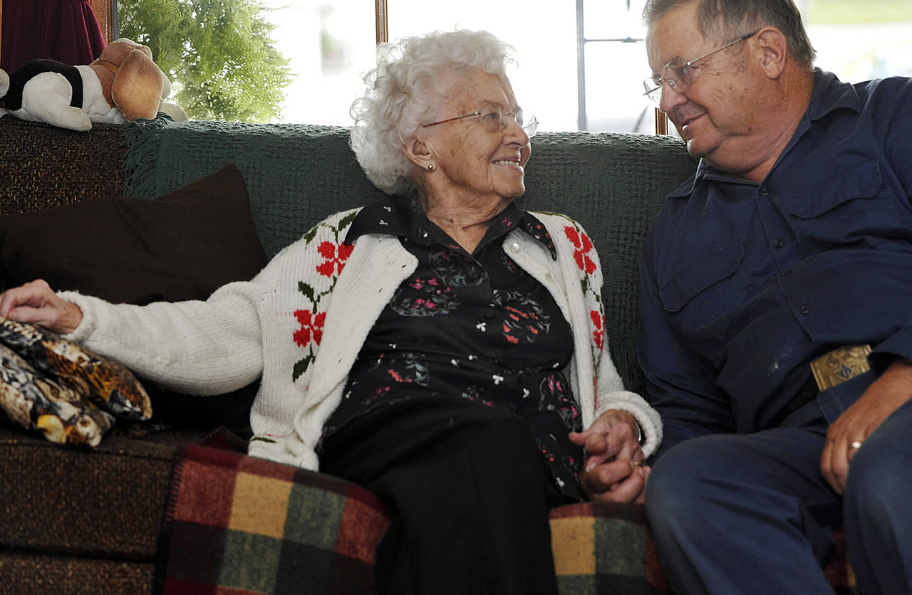 Lula Bunker (cq) and her son Robert Bunker, both of Cambridge, Maine, share memories on her 105th birthday Friday September 10, 2010. (Bangor Daily News/John Clarke Russ)