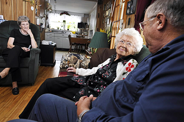Lula Bunker (cq), center, of Cambridge, Maine,  her daughter Marita Bunker Farrar, left, of Ripley  and her son Robert Bunker of Cambridge shared fond memories on her 105th birthday Friday September 10, 2010. (Bangor Daily News/John Clarke Russ)