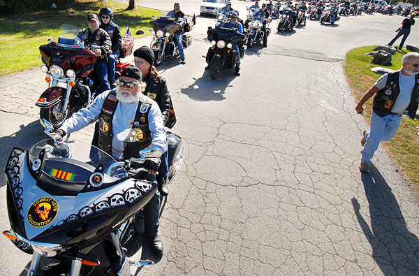 Wayne Lavoie and his wife Terri Crosby of Lucerne, Maine and other members of the Combat Veterans Motorcycle Association get ready to leave their rally point at the Days Inn in Bangor for their procession downtown and their 9/11 wreath laying ceremony at the Cole Family Land Transportation Museum in Bangor Saturday morning.  BANGOR DAILY NEWS PHOTO BY JOHN CLARKE RUSS