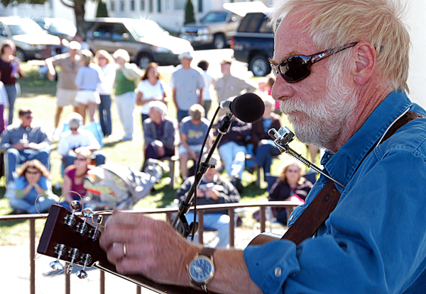 Singer-songwriter David Mallett tunes his guitar just before playing at the Trails End Festival of Millinocket on Saturday.  BANGOR DAILY NEWS PHOTO BY NICK SAMBIDES JR.