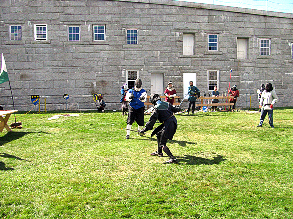 Two men engaged Saturday afternoon in a fencing match at the 9th