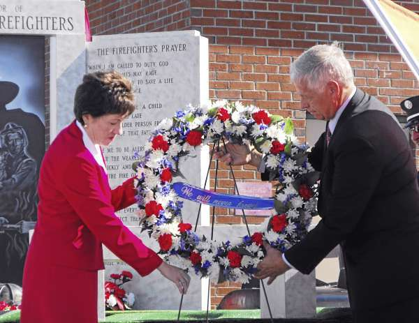 U.S. Sen. Susan Collins and Congressman Mike Michaud place a wreath in honor of firefighters who were killed in the 9/11 terrorist attacks during a 9/11 remembrance ceremony at the 47th annual Maine State Federation of Firefighters State Convention in Presque Isle on Saturday, Sept. 11, 2010. The ceremony marked the anniversary of the attacks nine years ago. (BANGOR DAILY NEWS PHOTO BY JEN LYNDS)