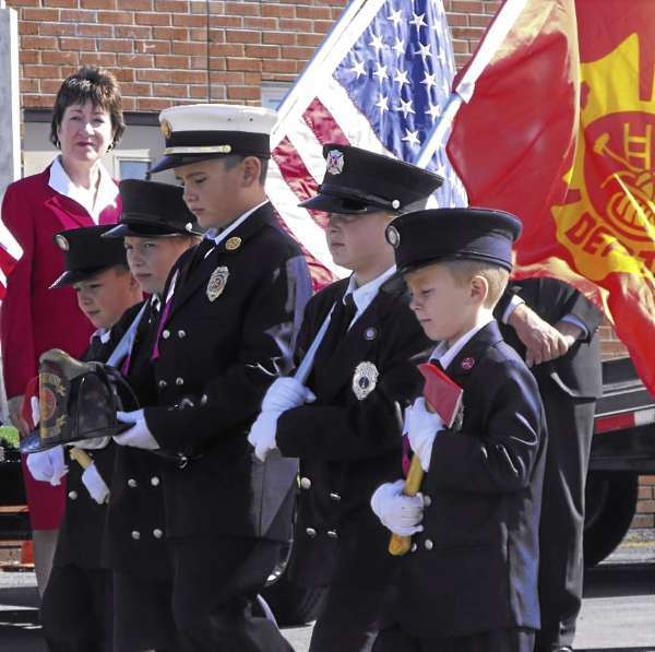 U.S. Sen. Susan Collins watches as a group of youth from Hudson and Bradley, including Ethan Bean, Kaitlynn Bean, Jacob Bean, Kennen Bean and Hannah Sirois, lead a parade of firefighters from a 9/11 remembrance ceremony during the 47th annual Maine State Federation of Firefighters State Convention in Presque Isle on Saturday, Sept. 11, 2010. More than 100 people attended the ceremony. (BANGOR DAILY NEWS PHOTO BY JEN LYNDS)