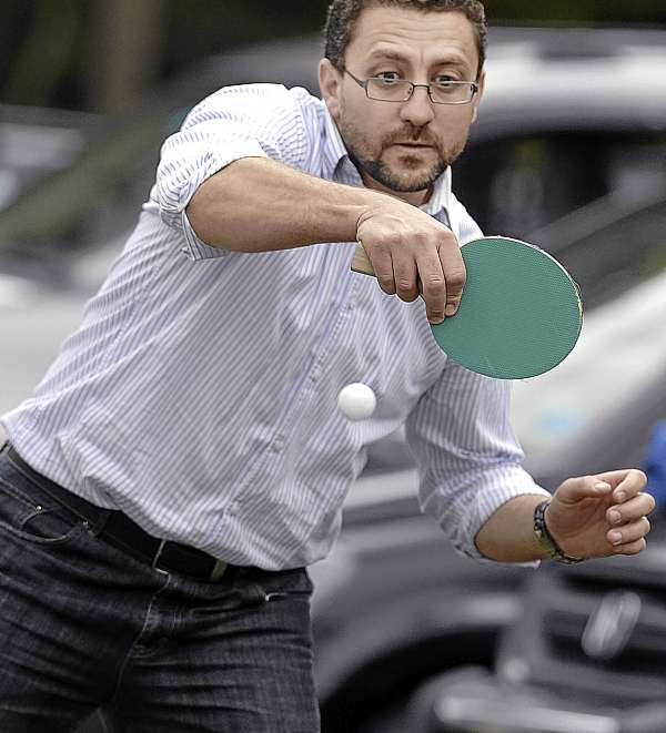 Ahmed Abdelmageed displays his tournament form at a ping pong match held at the Islamic Center of Maine in Orono in celebration of the end of Ramadan. Festivities were held for adults and children on the grounds of their new mosque on Park Street. Bangor Daily News/Michael C. York