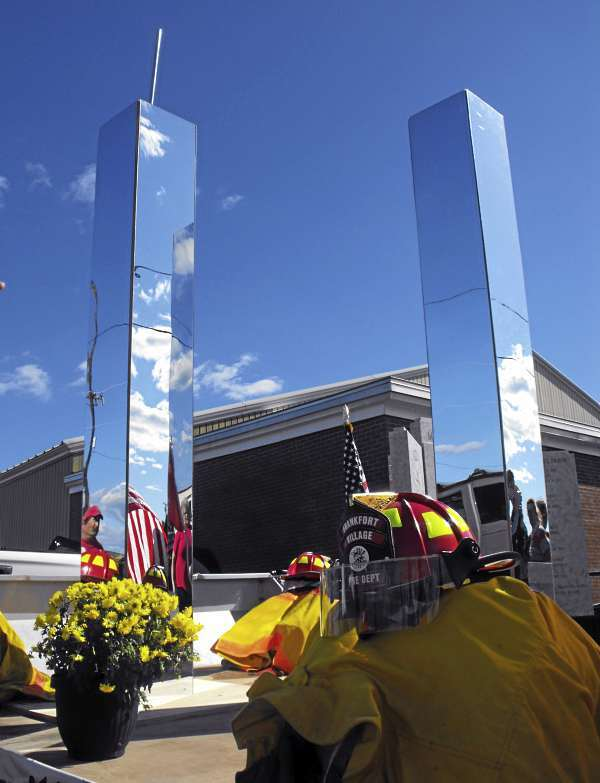 A replica of the World Trade Center's twin towers, surrounded by flowers, firefighter helmets and turnout gear, was part of the 9/11 remembrance ceremony during the 47th annual Maine State Federation of Firefighters State Convention in Presque Isle on Saturday, Sept. 11, 2010. Fire departments from across the state were represented at the ceremony. (BANGOR DAILY NEWS PHOTO BY JEN LYNDS)