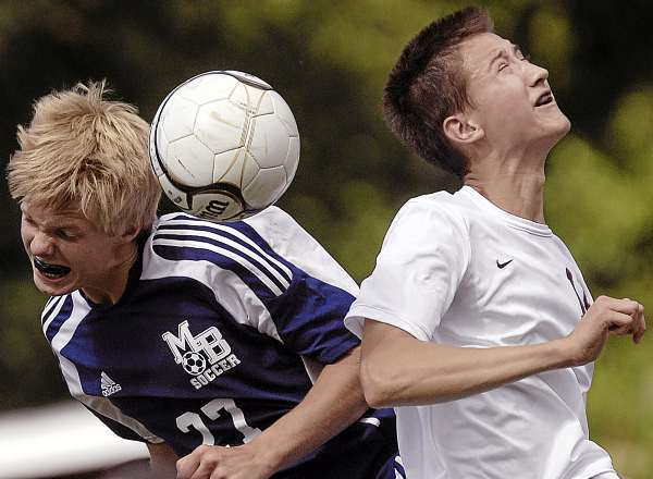 Mt Blue's Stephen Yardley, (27), and Bangor's Andy Prusaitis, (18), collide for a header in the second half of their game in Bangor, Saturday, Sept. 11, 2010. (Bangor Daily News/Michael C. York)