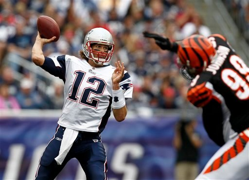 New England Patriots quarterback Tom Brady passes during the second half of New England's 38-24 win over the Cincinnati Bengals in an NFL football game at Gillette Stadium in Foxborough, Mass. Sunday, Sept. 12, 2010. (AP Photo/Winslow Townson)