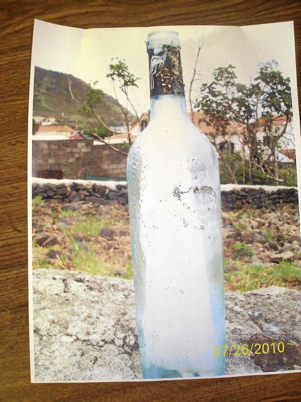 This bottle was found on the shores of an island in the Azores off the coast of Portugal this summer. It contained a message from three Adams School students in Castine written in 2008. BANGOR DAILY NEWS PHOTO BY RICH HEWITT