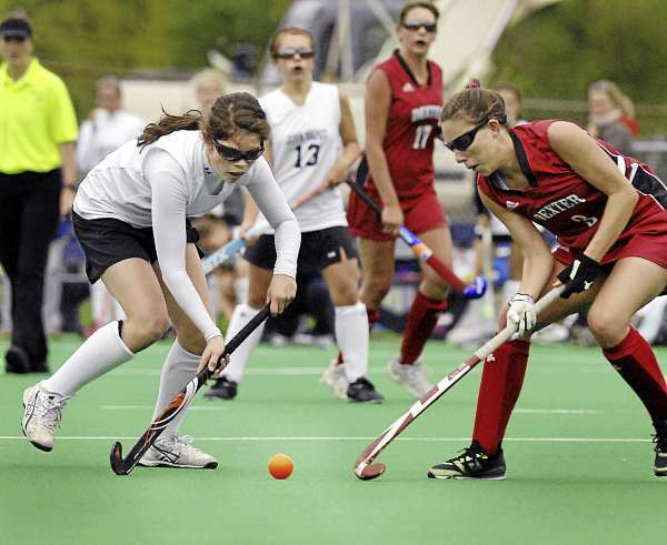 John Bapst's Christina Long, (15), tries to get the ball around Dexter's, (3), in the first half of their game in Orono at the U of Maine field Monday, Sept. 13, 2010. Bangor Daily News/Michael C. York