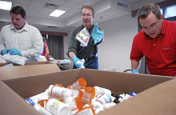 (BANGOR DAILY NEWS PHOTO BY BRIDGET BROWN)    CAPTION    First-year Husson University pharmacy students including (from left) Jonathan Anderson, Jon Simms and Paul Morrow unpack mailers filled with medicine Tuesday, Sept. 14, 2010, as part of the Safe Medicine Disposal for ME program, which provides Maine residents with a safe disposal option for unused and unwanted medicine. Mainers can find a listing of where they can pick up mailers for unwanted pharmaceuticals at http://www.safemeddisposal.com. (Bangor Daily News/Bridget Brown)