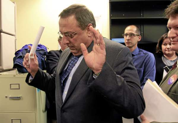 Republican gubernatorial candidate Paul LePage exits a news conference where he outlined his job-creation plan, in Augusta, Maine, on Monday, Sept. 13,  2010. LePage  deflected questions about taxes paid on a Florida home. He replied testily that questions about tax exemptions claimed by his wife already have been answered. The Kennebec Journal reported last week that Ann LePage claimed permanent residency in both states and could be fined in Florida. LePage's campaign described it as a &quotpaperwork error.&quot  (AP Photo/Pat Wellenbach)