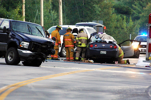 Rescue personnel at the scene of a head-on crash involving a pickup truck and car on Route 1A in Dedham late Tuesday afternoon, Sept. 14, 2010. (Bangor Daily News.Scott Haskell)