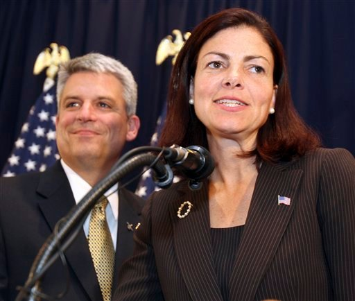 Republican U.S. Senate hopeful  Kelly Ayotte talks to supporters with her husband Joe Daley at her side in Concord, N.H., Tuesday, Sept. 14,2010. Ayotte is in a close race with Ovide Lamontagne for the Republican nomination in a race still too close to call. (AP Photo/Jim Cole)