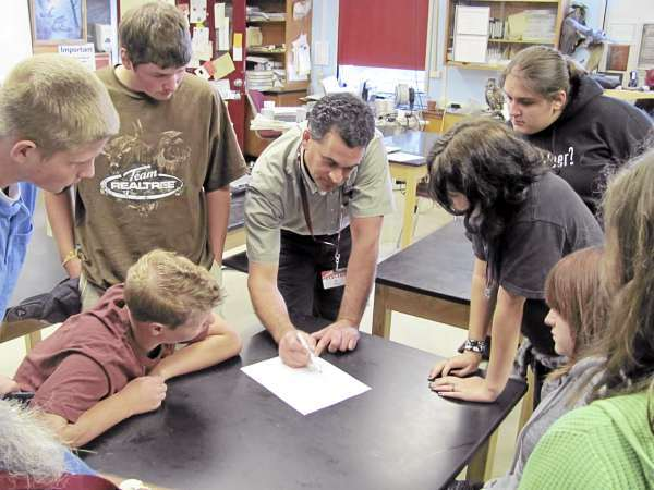 W/ Cousinis' story &quotusdatalk&quot.  A group of taxidermy students at Nokomis Regional High School on Sept. 15, 2010 and Adam Vashon, a biologist with the USDA's Wildlife Services Program, prioritize a list of preserved bird skins he needs for training airport personnel how to keep birds away from aircraft.(Bangor Daily News/Christopher Cousins)