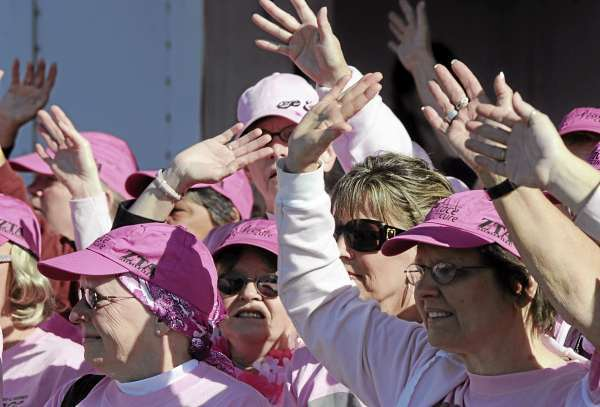 Breast cancer survivors wave to the thousands of people who gathered for the 13th annual Susan G. Komen Race for the Cure during the survivor ceremony on the Bangor Waterfront on Sunday, Sept. 20, 2009.  (BANGOR DAILY NEWS PHOTO BY GABOR DEGRE)  CAPTION  Breast cancer survivors wave to the thousads of people who gathered for the 13th annual Susan G. Komen Race for the Cure during the survivor ceremony at the Bangor Waterfront Saturday.   (Bangor Daily news/Gabor Degre)
