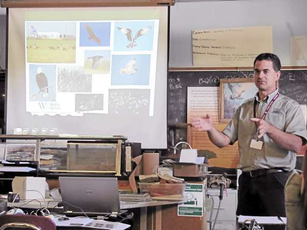 story &quotusdatalk&quot.  Adam Vashon, a biologist with the USDA's Wildlife Services Program, explains to a taxidermy class at Nokomis Regional High School Wednesday, Sept. 15, 2010 why he needs preserved examples of various bird species for his work of protecting aircraft from colliding with birds. The class will preserve several bird skins for Vashon in the coming weeks. (Bangor Daily News/Christopher Cousins)