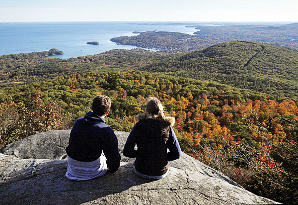LOOKOUT LEDGES   A couple takes in the view from the ocean lookout ledges on 1375-foot Mount Megunticook recently at Camden Hills State Park in Camden. (AP Photo/Robert F. Bukaty)