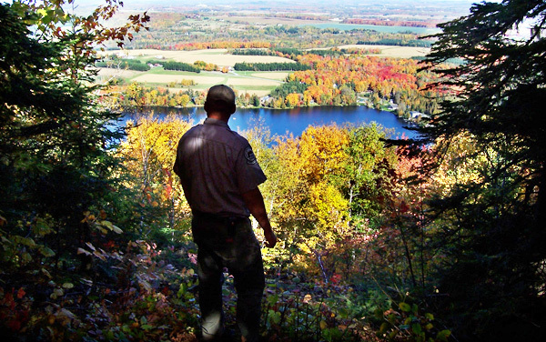 Park Ranger Alan Cleaves views the Maine fall foliage at Aroostook State Park, Presque Isle, during the 2009 foliage season. (Photo courtesy of the Maine Bureau of Parks and Lands)