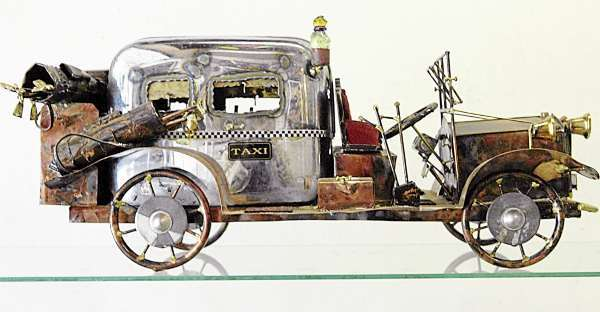 This taxi--made using an old toaster oven and other everyday objects is one of many whimsical metal sculptures Ernie Abdelnour has fabricated in his Town Hill studio. Photographed Wednesday morning, September 15, 2010.  (Bangor Daily News/John Clarke Russ)
