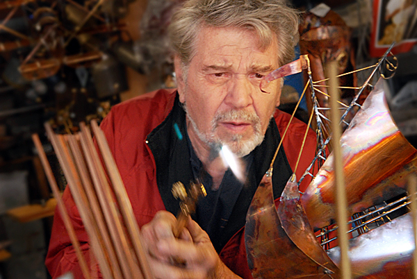 At his studio in Town Hill, Ernie Abdelnour used an acetylene torch to enhance the luster on the metal sails of a small-scale ship he fabricated from various metal objects--new and found. Photographed Wednesday morning, September 15, 2010.  (Bangor Daily News/John Clarke Russ)
