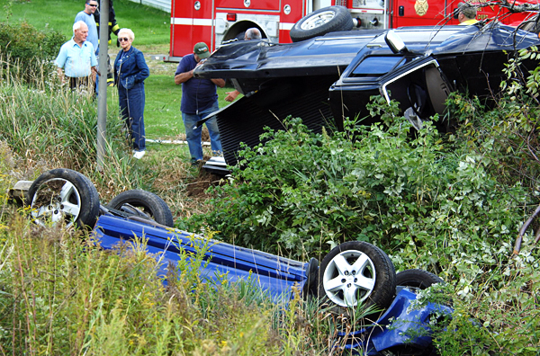 A car, foreground, and a pickup truck were involved in a double rollover accident on Route 9 (Western Ave.) in Newburgh Thursday afternoon, Sept. 16, 2010.  State police are investigating the accident, which slowed traffic for over an hour.  (Bangor Daily News/Scott Haskell)