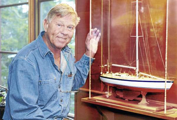This photo made April 5, 2005, shows Dodge Morgan next to a model of his boat, American Promise.  Morgan, the first American to complete a solo sail around the globe without stopping, died Tuesday, Sept. 14, 2010,  of cancer, at a Boston hospital. He was 78. (AP/Portland Press Herald, Gordon Chibroski)