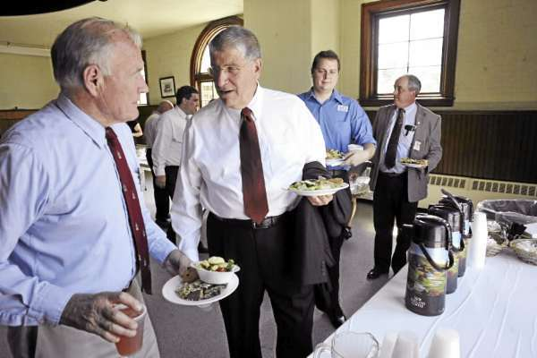 CAPTION Independent gubernatorial candidate Eliot Cutler (second from left) talks with former Bangor Mayor and Farrington Financial Group president Frank Farrington (far left) before speaking to Bangor Rotarians at their luncheon at the Seminary Hill Campus in Bangor Tuesday afternoon, August 17, 2010. Behind them are Cutler's eastern Maine field organizer David Jones of Bangor and WBRC Architects/ Engineers CEO Stephen Rich (far right). (Bangor Daily News/John Clarke Russ)    (WEB EDITION PHOTOP)