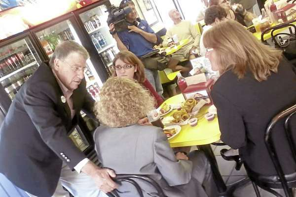 Eliot Cutler at Simones' Hot Dog Stand in Lewiston talking with three women, who are all staffers for Sen. Susan Collins, during a campaing stop on Tuesday, Aug. 24, 2010. (Bangor Daily News/Eric Russell)
