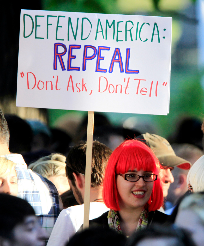 A member of the crowd shows her support as recording artist Lady Gaga speaks at a rally in support of repealing the military's &quotdon't ask, don't tell&quot policy for gay service members, in Portland, Maine, on Monday, Sept. 20, 2010.  (AP Photo/Pat Wellenbach)
