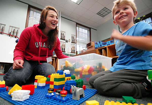 Luelen Suchan, University of Maine education major, laughs with a three-year-old while working in a laboratory class of pre-schoolers at the Katherine Miles Durst Child Development Learning Center on U Maine's Orono campus Friday morning, September 17, 2010. Suchan is a first generation college student who has had support from TRIO, a federally funded program designed to increase college retention and graduation rates. (NOTE TO EDITORS: The parent and administrators asked that we not provide his name but we can include him in the photo.) (Bangor Daily News/John Clarke Russ)