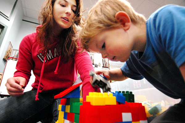 Luelen Suchan, University of Maine education major, helps a three-year-old build a Lego house while working in a laboratory class of pre-schoolers at the Katherine Miles Durst Child Development Learning Center on U Maine's Orono campus Friday morning, September 17, 2010. Suchan is a first generation college student who has had support from TRIO, a federally funded program designed to increase college retention and graduation rates. (NOTE TO EDITORS: The parent and administrators asked that we not provide his name but we can include him in the photo.) (Bangor Daily News/John Clarke Russ)