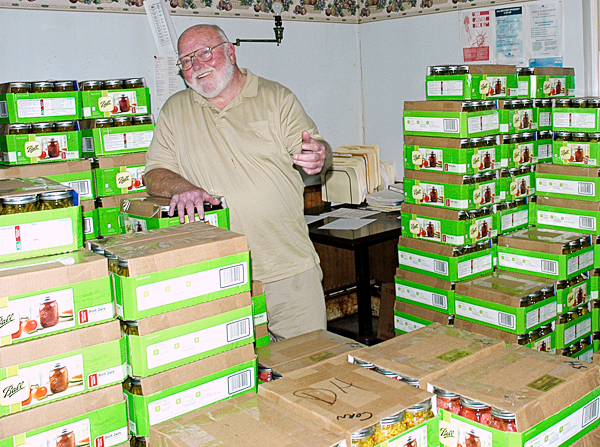 Mike Henderson is never happier than when surrounded by mason jars full of his pickled products ready for market. Henderson spends three days a week on the road delivering Mike's Maine Pickles throughout New England. (Photo by Julia Bayly)