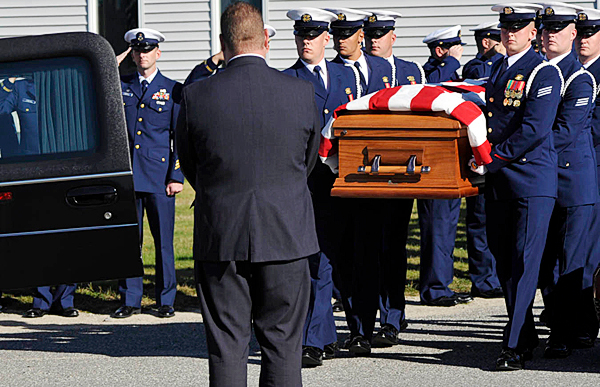 Members of the Coast Guard Honor Guard from Alexandria , VA carry the casket holding Carlos Tapia to a hearse after Tuesday's funeral service for him , his wife, Rachelle Renae Parker, and their daughter, MacKenzie Renae Gray, at Beals Elementary School. Their tragic death in a traffic accident last week has left the community in mourning.  BANGOR DAILY NEWS PHOTO BY JOHN CLARKE RUSS