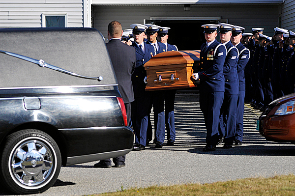 Members of the Coast Guard Honor Guard from Alexandria , VA carry the casket holding Rachelle Renae Parker to a hearse after Tuesday's funeral service for her , her husband Carlos A. Tapia and their daughter MacKenzie Renae Gray at Beals Elementary School. Their tragic death in a traffic accident last week has left the community in mourning.   BANGOR DAILY NEWS PHOTO BY JOHN CLARKE RUSS