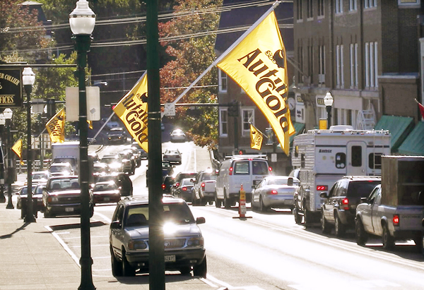 Gold and black flags line Main Street in Ellsworth alerting travelers to the start of the 27th annual Autumn Gold celebration this weekend. The annual event features an car show, boat rides, a chowder cookoff and a variety of other events throughout the weekend. (Bangor Daily News Photo by Rich Hewitt)