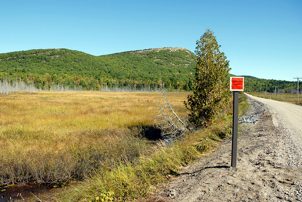 Recreationists traveling east-bound on the Down East Sunrise Trail in Sullivan encounter excellent views of Schoodic Mountain, which is identified by a sign placed alongside the trail. (Bangor Daily News/Brian Swartz)